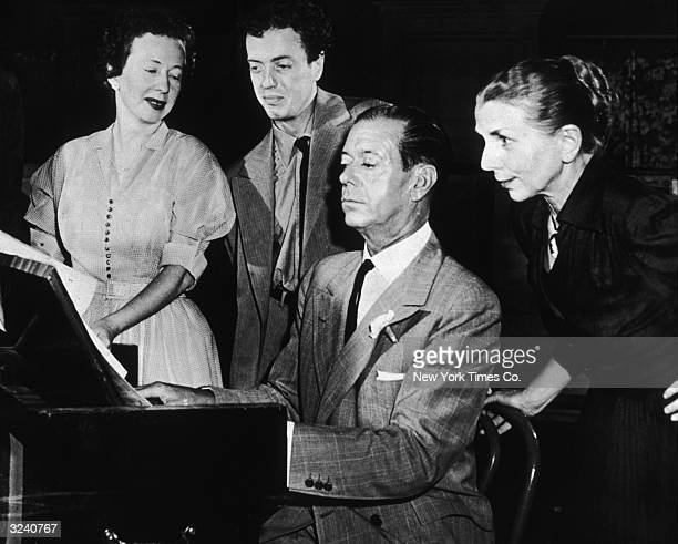 American musician and composer Cole Porter plays a score for choreographer Agnes de Mille producer Saint Subber and choreographer Hanya Holm for the...