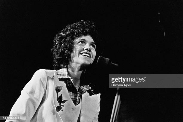 American musician and composer, Margie Adam, performs on stage at Jordan Hall, New England Conservatory, Boston, Massachusetts, 15th April 1977.