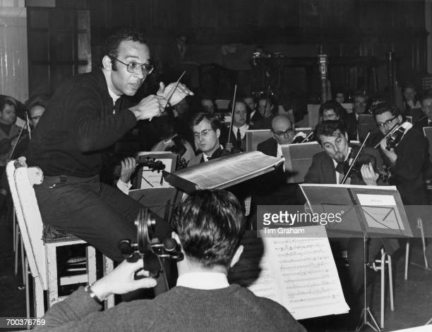 American musician and conductor Henry Lewis conducting the Royal Philharmonic Orchestra in rehearsal at the Royal festival Hall London 16th December...