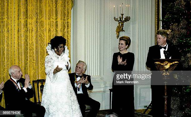American musician and Kennedy Center Honors Awards recipient Aretha Franklin is applauded by from left fellow honorees musician composer Morton Gould...