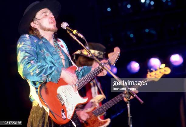 American musician and lead singer Stevie Ray Vaughan of the group Stevie Ray Vaughan and Double Trouble, plays on stage during the Soul to Soul Tour...