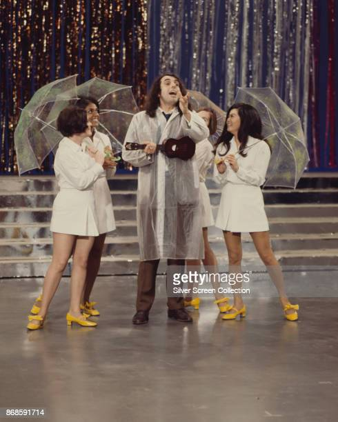 American musician and musical archivist Tiny Tim performs with unidentified dancers during a rehearsal for the television variety special 'The Young...