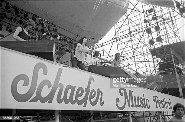 American musician and poet Patti Smith and her group performs at the Schaefer Music Festival in Central Park New York New York July 9 1976 Ivan Kral...