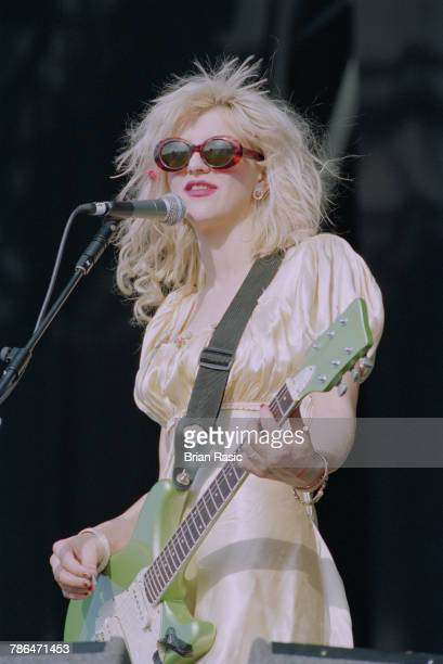 American musician and singer Courtney Love performs live on stage with rock group Hole at the 1994 Reading Festival in England on 26th August 1994