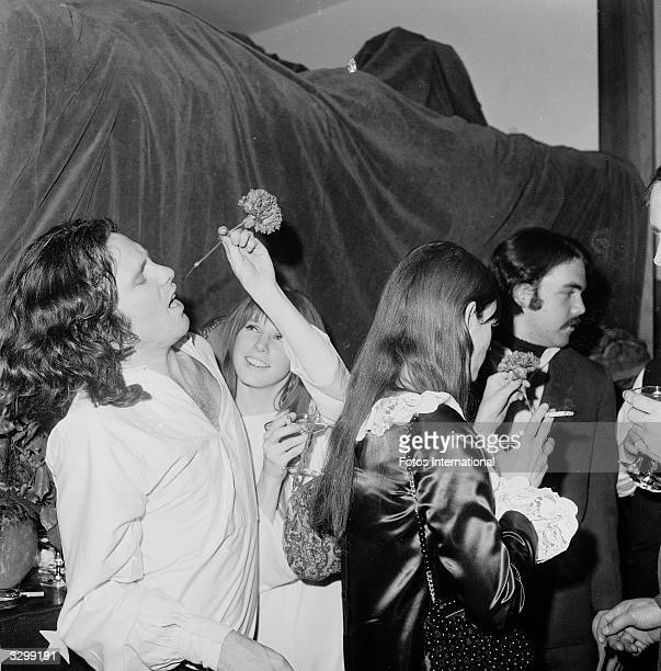 American musician and singer Jim Morrison and Pamela Courson attend the opening of 'The Beard' at the Warner Playhouse California January 24 1968
