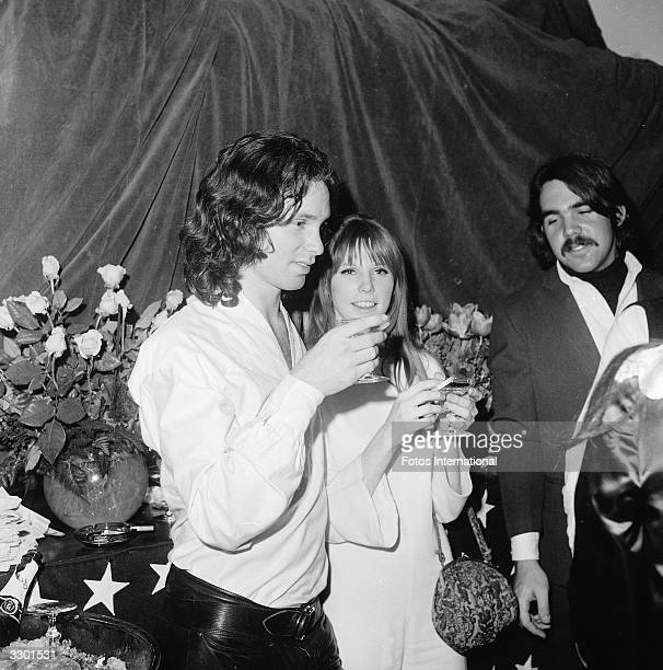 American musician and singer Jim Morrison and Pamela Courson have a drink at the opening of 'The Beard' at the Warner Playhouse California January 24...