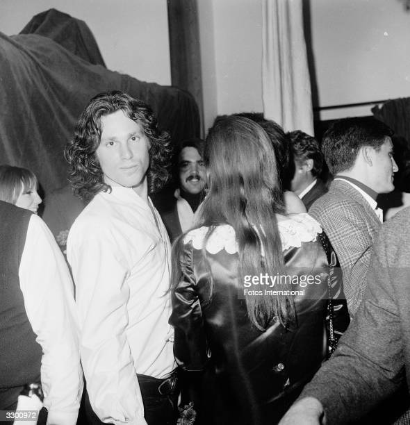 American musician and singer Jim Morrison poses for the camera at the opening of 'The Beard' at the Warner Playhouse California January 24 1968
