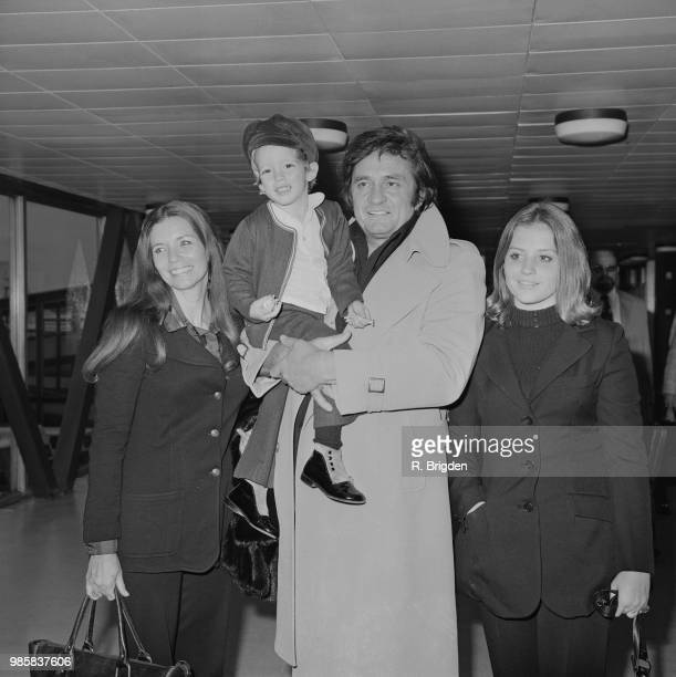 American musician and singer Johnny Cash pictured with his wife June Carter Cash son John Carter Cash and daughter Cindy Cash at Heathrow airport in...