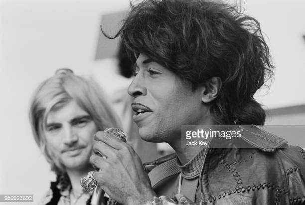 American musician and singer Little Richard pictured with Screaming Lord Sutch behind speaking at a press conference to promote his appearance at the...