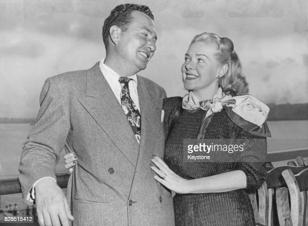 American musician and singer Phil Harris and his wife actress Alice Faye arrive home in New York on the liner 'SS Queen Elizabeth' after a trip to...