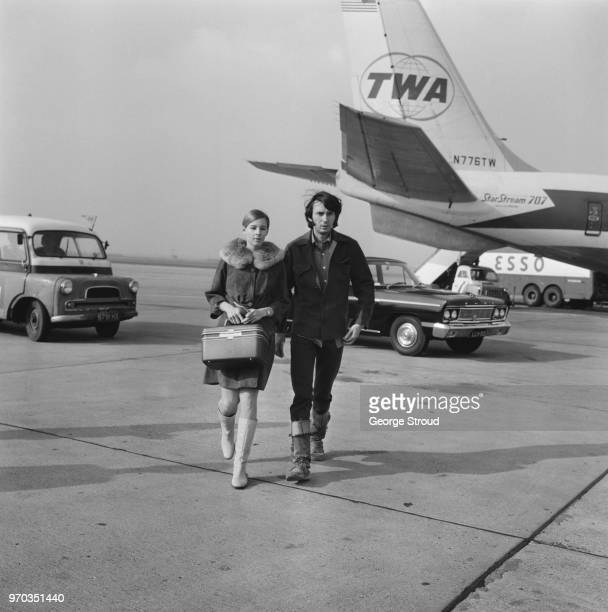 American musician and songwriter of Michael Nesmith of rock band The Monkees with his wife Phyllis Ann Barbour at Heathrow Airport London UK 14th...