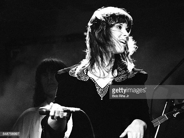 American musician Ann Wilson of the rock group Heart performs onstage at the Universal Amphitheatre Los Angeles California July 15 1977 Visible in...