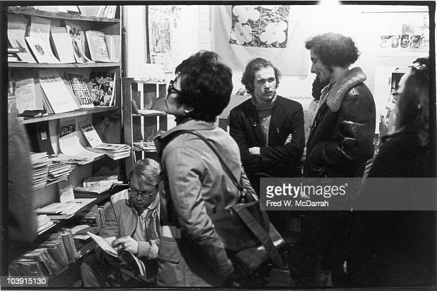 American musician author and activist Ed Sanders speaks with customer poet Nelson Barr inside Sanders' Peace Eye bookstore and cultural center New...