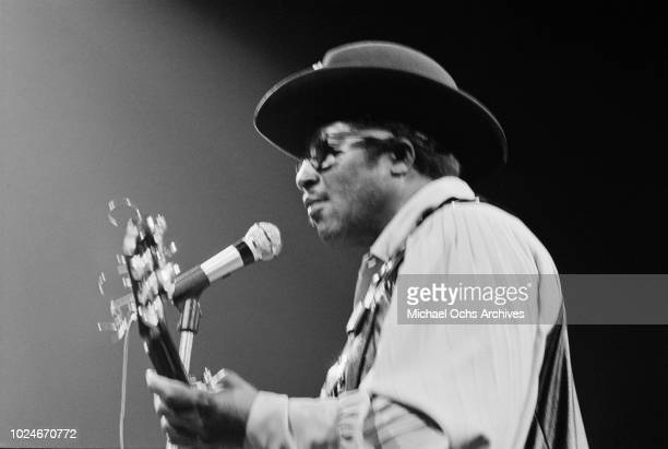 American musician Bo Diddley performs at Madison Square Garden in New York City during the concert movie 'Let the Good Times Roll' 1972