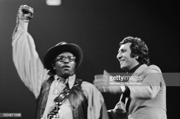 American musician Bo Diddley performs at Madison Square Garden in New York City during the concert movie 'Let the Good Times Roll' 1972 On the right...
