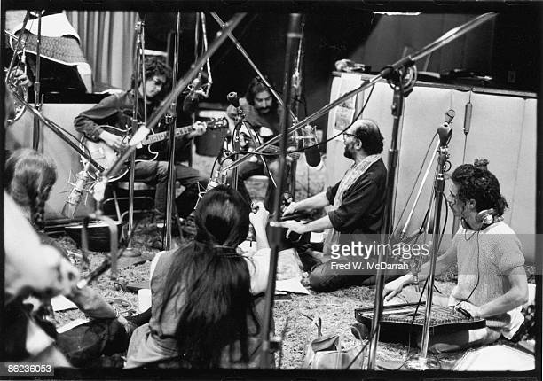 American musician Bob Dylan and Beat poet Allen Ginsberg among others at a recording session New York New York November 13 1971 Pictured are...