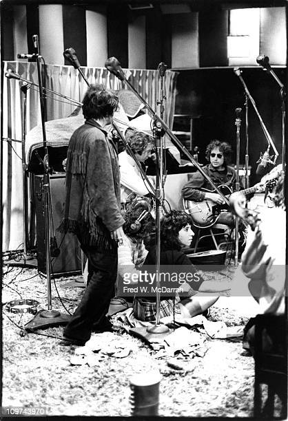 American musician Bob Dylan sits among others including Gregory Corso David Amram Ed Sanders and Denise Mercedes at a recording session New York New...