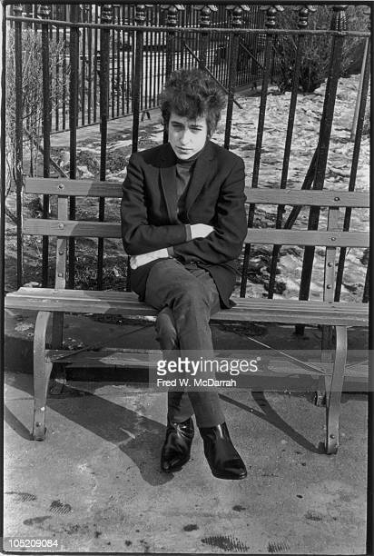 American musician Bob Dylan sits on a bench in Christopher Park New York New York January 22 1965