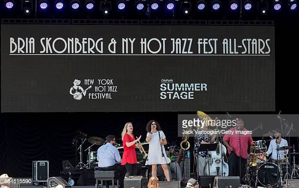 American musician Bria Skonberg plays trumpet as she leads her band the NY Hot Jazz Festival AllStars during a performance at Central Park...