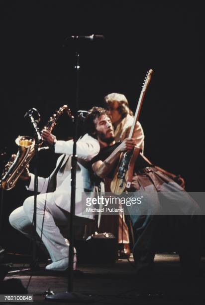 American musician Bruce Springsteen performs live on stage with saxophone player Clarence Clemons of the E Street Band at Hammersmith Odeon in London...
