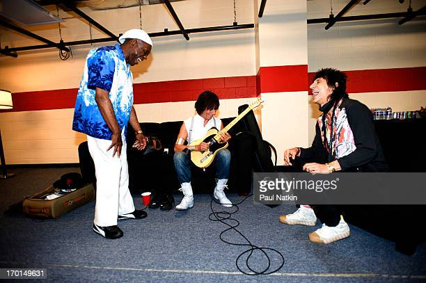 American musician Buddy Guy shares a laugh with British musicians Jeff Beck and Ron Wood backstage at Eric Clapton's Crossroads Guitar Festival at...
