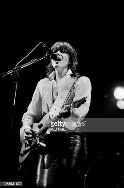 American musician Chrissie Hynde, of the group Pretenders, plays guitar as she performs at the Aragon Ballroom, Chicago, Illinois, April 13, 1984.