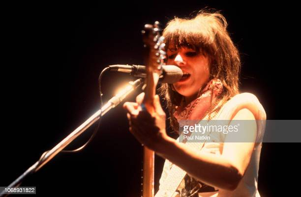 American musician Chrissie Hynde, of the group Pretenders, plays guitar as she performs at the Park West, Chicago, Illinois, April 25, 1980.