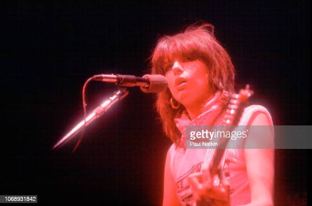 American musician Chrissie Hynde of the group Pretenders plays guitar as she performs at the Park West Chicago Illinois April 25 1980