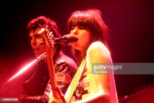 American musician Chrissie Hynde, of the group Pretenders, plays guitar as she performs at the Park West, Chicago, Illinois, April 25, 1980. Visible...