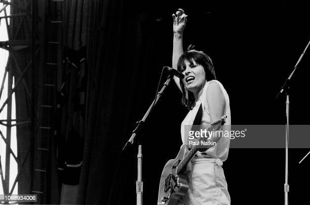 American musician Chrissie Hynde, of the group Pretenders, plays guitar as she performs at the US Festival, Ontario, California, May 30, 1983.