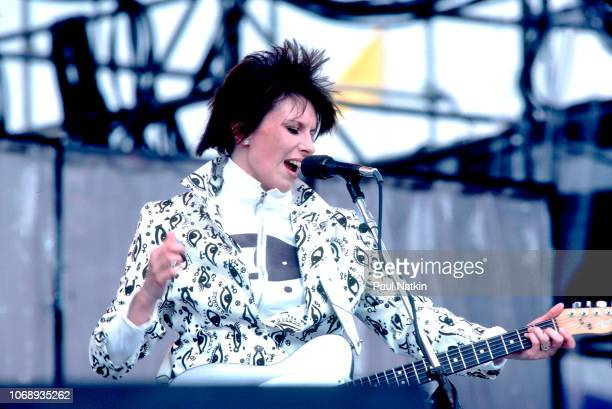 American musician Chrissie Hynde of the group Pretenders plays guitar as she performs during the Live Aid concert at Veteren's Stadium Philadelphia...