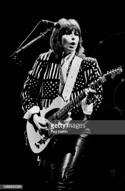 American musician Chrissie Hynde of the group Pretenders plays guitar as she performs at the Poplar Creek Music Theater in Hoffman Estates Illinois...