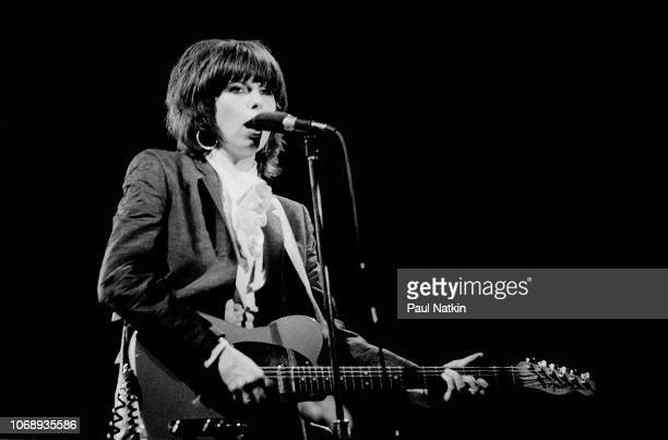 American musician Chrissie Hynde, of the group Pretenders, plays guitar as she performs at the Aragon Ballroom in Chicago, Illinois, August 22, 1981.