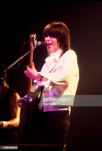 American musician Chrissie Hynde, of the group Pretenders, plays guitar as she performs at the Riviera Theater, Chicago, Illinois, September 8, 1980.