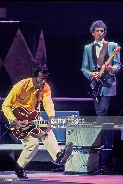 American musician Chuck Berry and British musician Keith Richards on stage at the Fox Theater for a performance filmed as the 'Hail Hail Rock and...