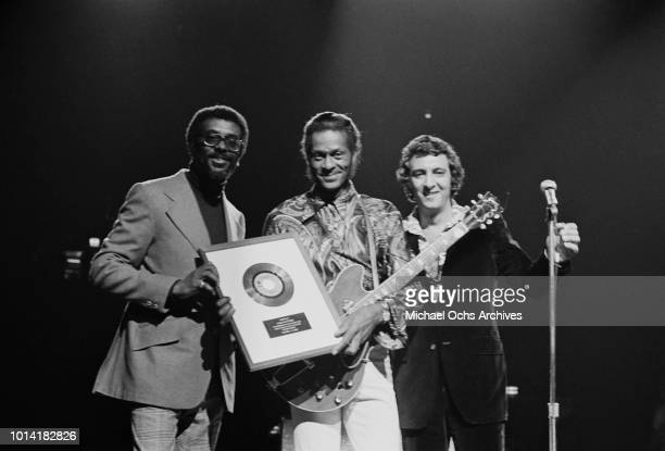 American musician Chuck Berry receives a Gold Disc on stage at the Rock and Roll Revival show in Madison Square Garden New York City 13th October...