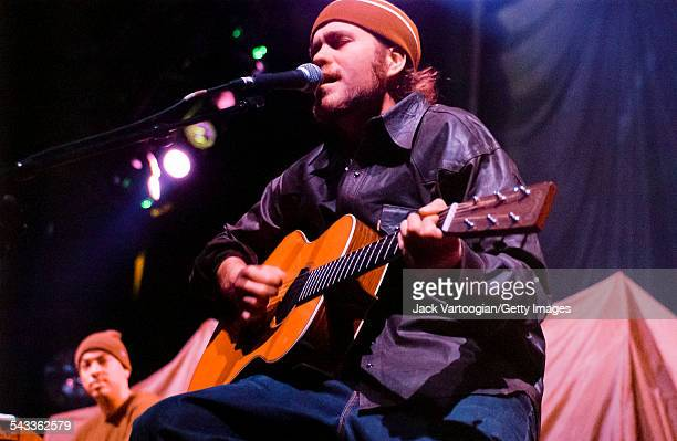 American musician Citizen Cope plays guitar as he performs onstage at the Hammerstein Ballroom New York New York March 4 2002 Behind him Chris Joyner...