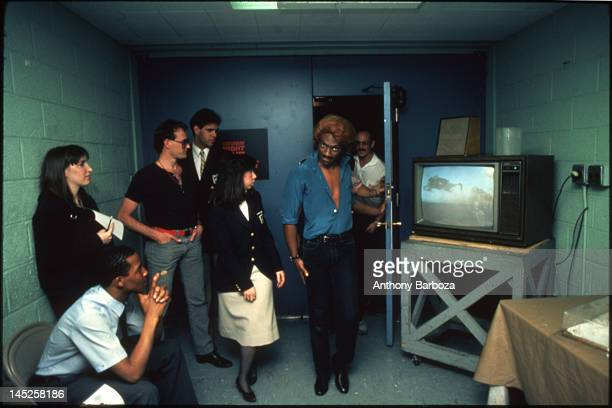 American musician comedian and actor Eddie Murphy in costume as the character Dion backstage during an episode of 'Saturday Night Live' New York New...