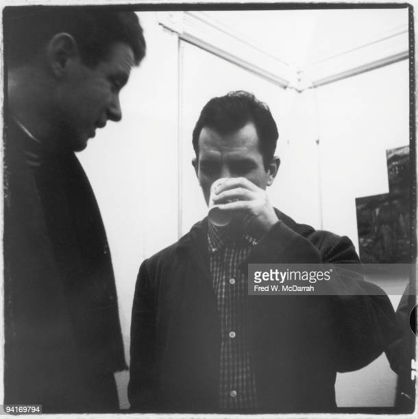 American musician composer and conductor David Amram and author Jack Kerouac talk together at the Hansa Gallery New York New York March 16 1959 The...