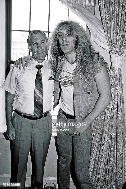 American musician Dee Snider of Twisted Sister with his father Bob Snider pictured in a hotel room during the PMRC senate hearing at Capitol Hill...