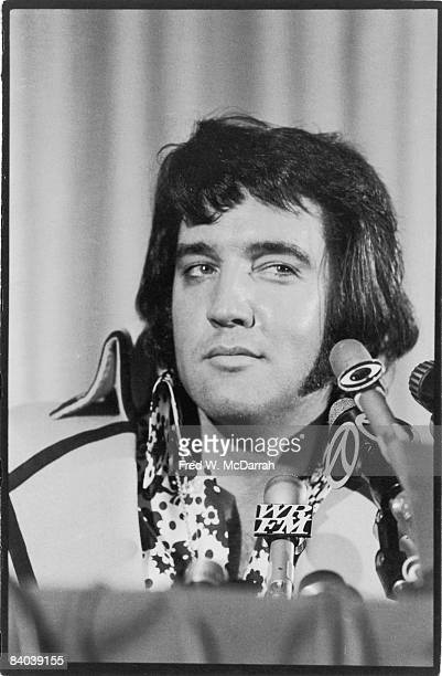 American musician Elvis Presley appears at a press conference to discuss his forthcoming perfermance at Madison Square Garden New York New York June...