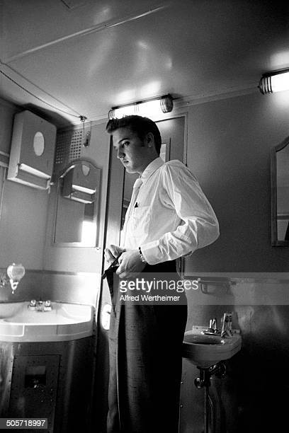 Alfred Wertheimer/Getty Images American musician Elvis Presley dresses in the washroom of the New York to Memphis train July 4 1956 Elvis had been in...