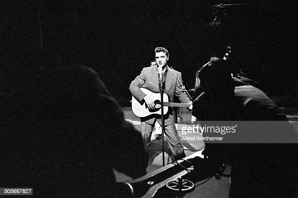 Alfred Wertheimer/Getty Images American musician Elvis Presley performs on stage at CBSTV's Studio 50 during the rehearsal for his appearance on the...