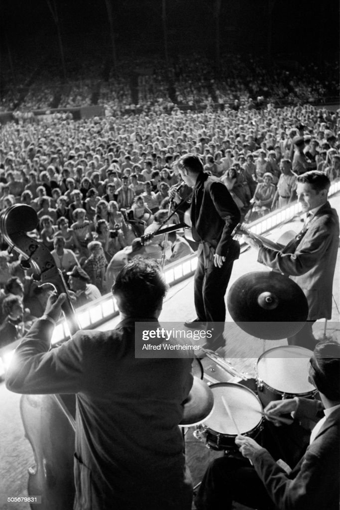 Alfred Wertheimer/Getty Images) American musician (and actor) Elvis Presley (1935 - 1977) performs, with his band, on stage at Russwood Park, Memphis, Tennessee, July 4, 1956.