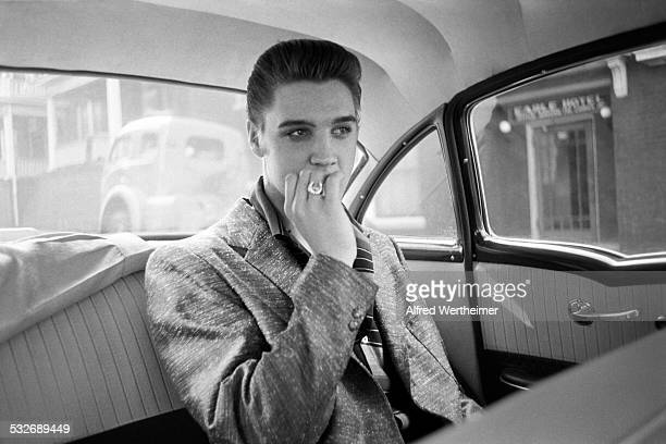 Alfred Wertheimer/Getty Images American musician Elvis Presley rides in the back of a car New York New York June 29 1956 He was in New York for an...