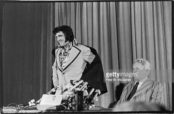American musician Elvis Presley smiles as he appears at a press conference to discuss his forthcoming perfermance at Madison Square Garden New York...