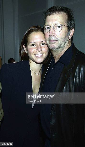 American musician Eric Clapton and wife Melia Mcennery attend the cocktail party to celebrate Giorgio Armani A Retrospective at the Royal Academy on...