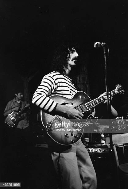 American musician Frank Zappa plays guitar as he performs onstage with his band the Mothers of Invention New York New York May 20 1970