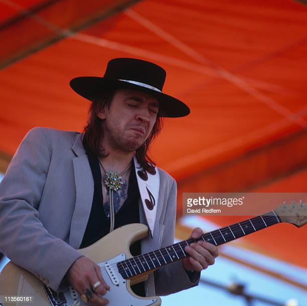 American musician, guitarist and singer Stevie Ray Vaughan performs live on stage playing a cream coloured Fender Stratocaster guitar during a...