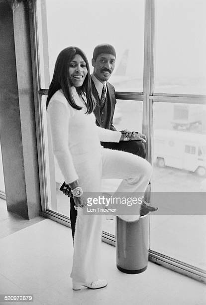 American musician Ike Turner and his wife, singer, dancer, and actress Tina Turner at London Airport on their way to Los Angeles, London, 11th March...